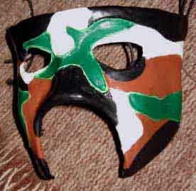 Supa Soul-ja half mask with a brown, green, black and white camouflage pattern.
