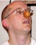 Lynn trying on his unpainted clown nose