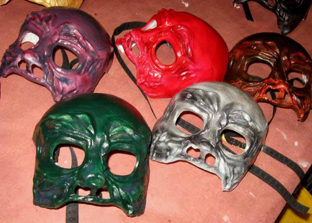 5 finished skull masks in green, gray silver, purple, red and brownish red