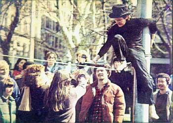 Philippe Petit wearing custom top hat walking the hi-wire