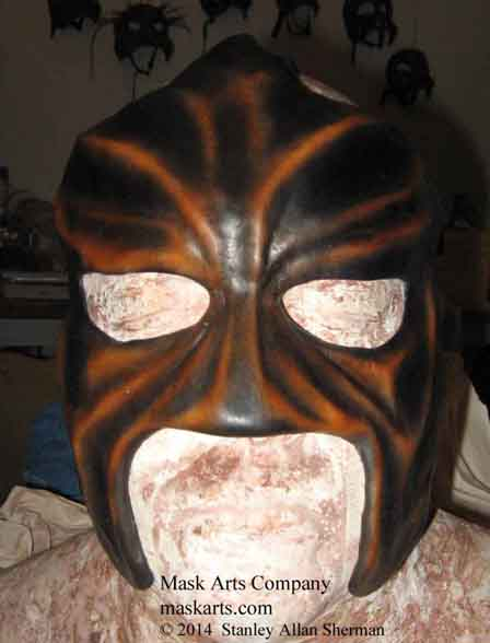 Abyss wrestling mask, front view, black & tan  half mask